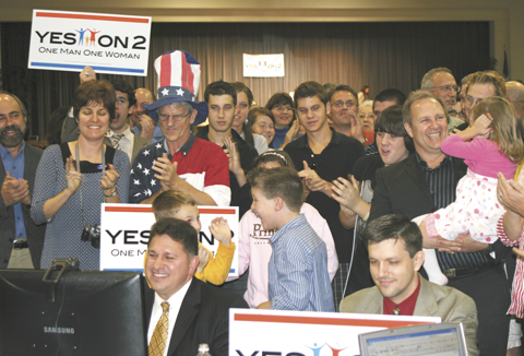 John Stemberger (l), chairman of Yes2Marriage.org, participates in a Webcast with Focus on Family while supporters celebrate passage of the Florida Marriage Protection Amendment.