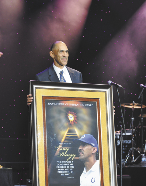 TESTAMENT Tony Dungy is honored with Lifetime of Inspiration award at the 10th annual Super Bowl Gospel Celebration at the University of South Florida Sun Dome Jan. 30.